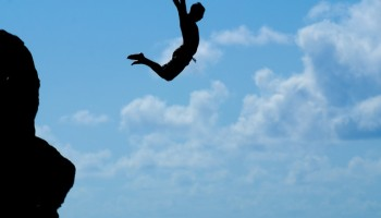 That's me, jumping off the rock at Waimea Bay.